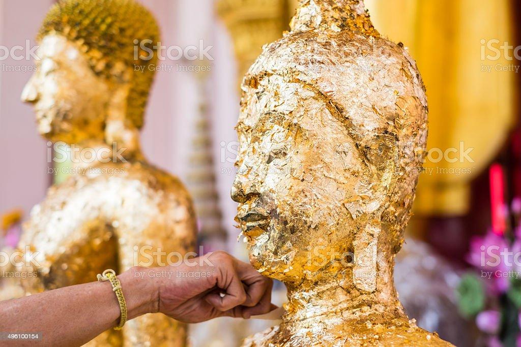 Gilded statue of Buddha stock photo