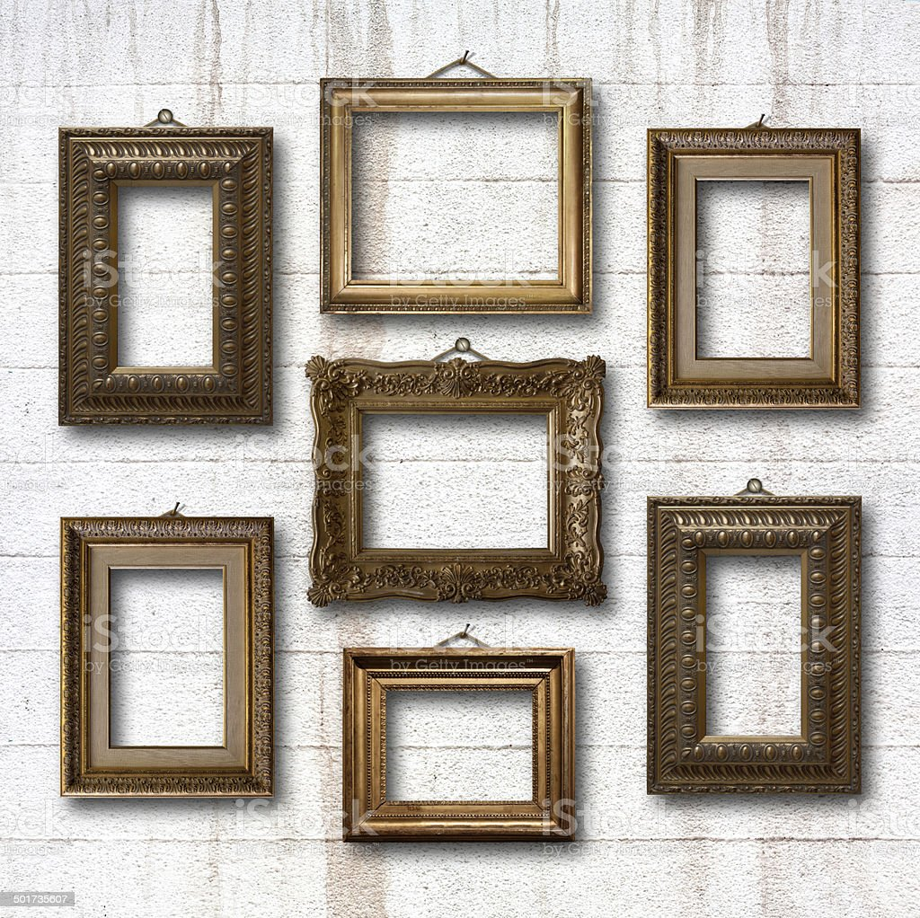 Gilded wooden frames for pictures on old stone wall stock photo