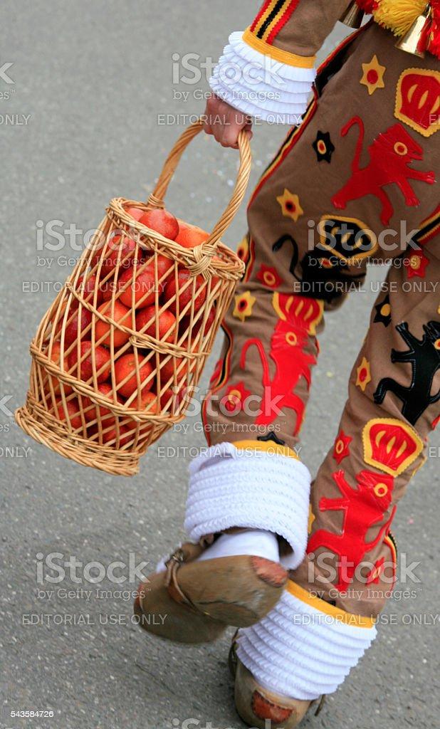 'Gille' wearing orange basket, Binche Carnival, Belgium. stock photo