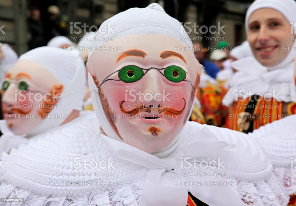 'Gille' wearing their traditional wax mask, Binche Carnival, Belgium. stock photo