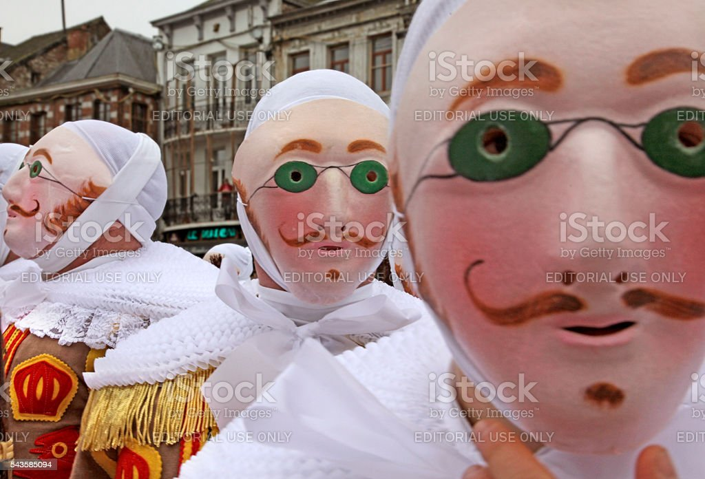 'Gille' wearing their wax mask, Binche Carnival, Belgium. stock photo