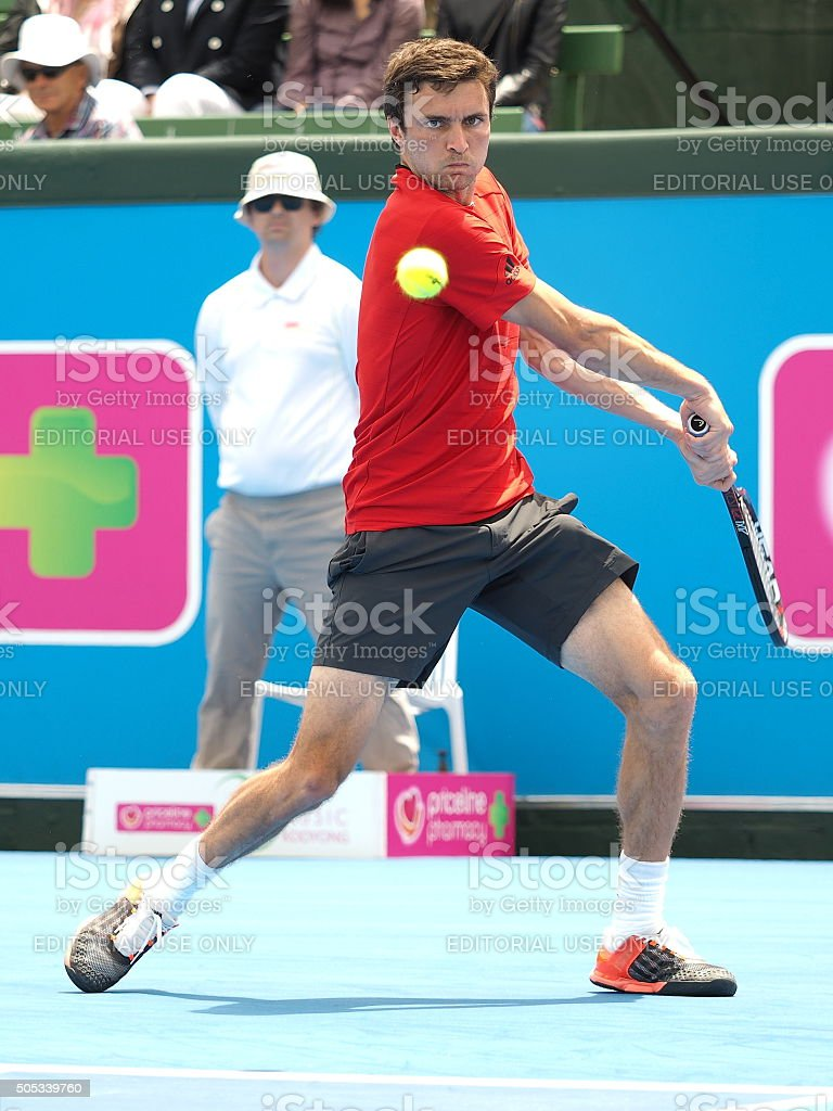 Gilles Simon winds up for a backhand stock photo