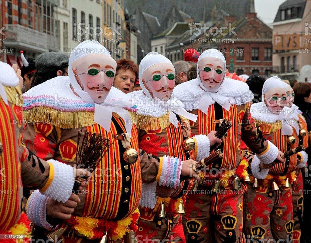 Gilles with wax mask dancing, Binche Carnival, Belgium. stock photo