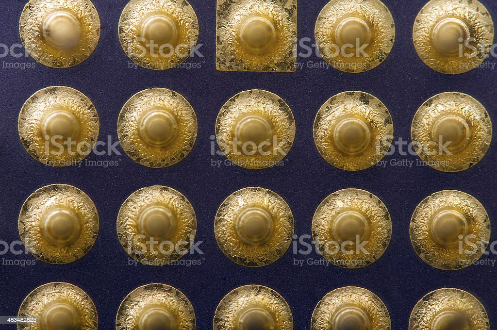 Gilt legs of the computer's processor. Abstract background. Macr royalty-free stock photo