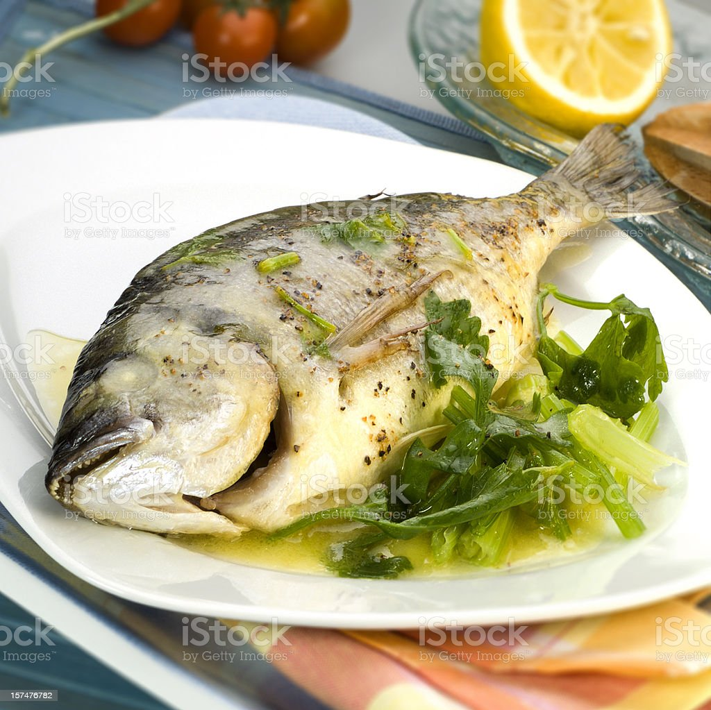 Gilt-head bream with celery and sauce royalty-free stock photo
