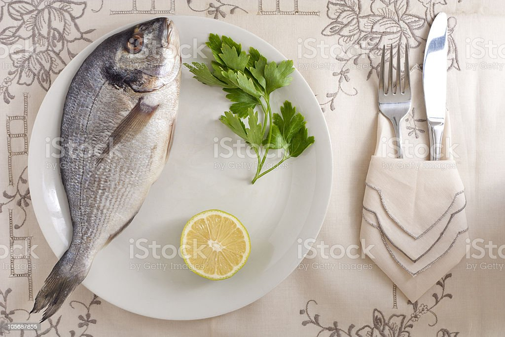 Gilthead with Lemon and Parsley royalty-free stock photo