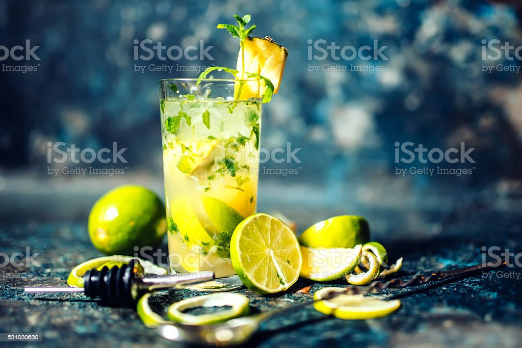 Gin and lime cocktail with pineapple and ice served cold stock photo