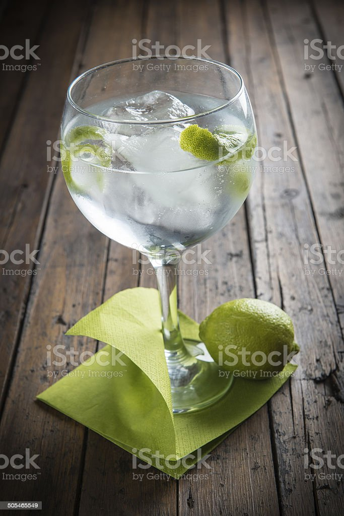 Gin and tonic garnished with lime stock photo