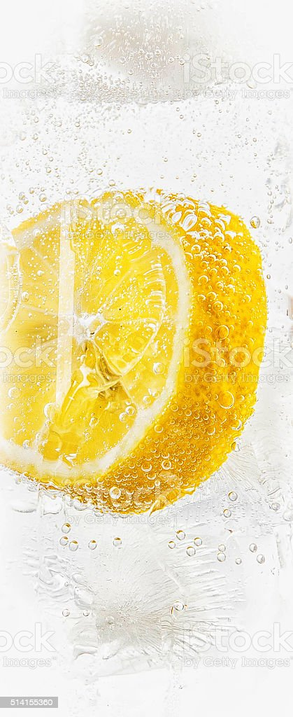 Gin and tonic with ice and lemon stock photo