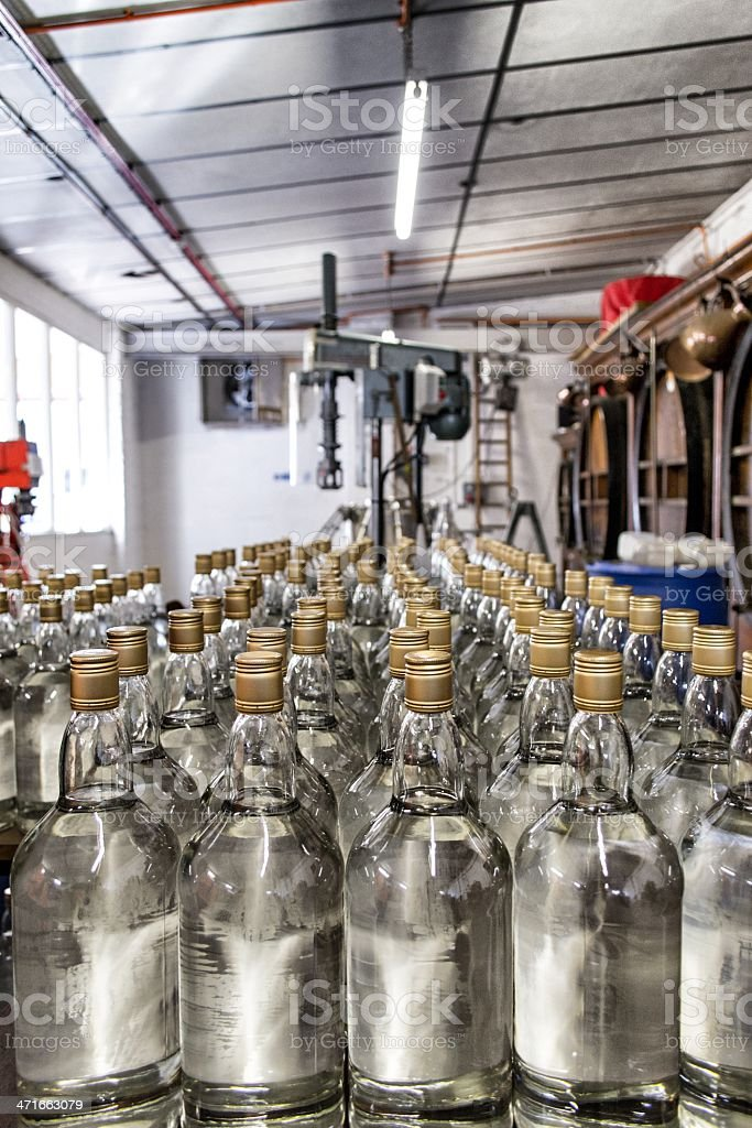 Gin bottles at a distillery royalty-free stock photo