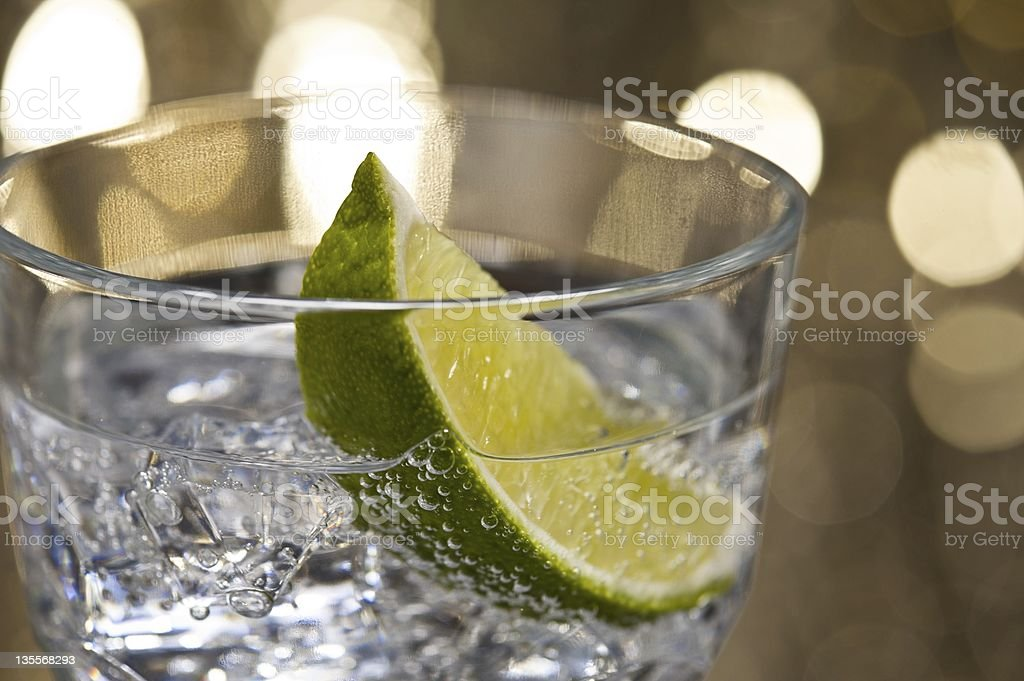 Gin Tonic Cocktail in front of a brown gold background stock photo