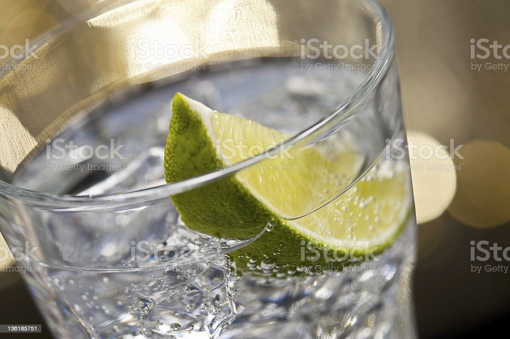 Gin Tonic Cocktail in glass with a brown gold background stock photo