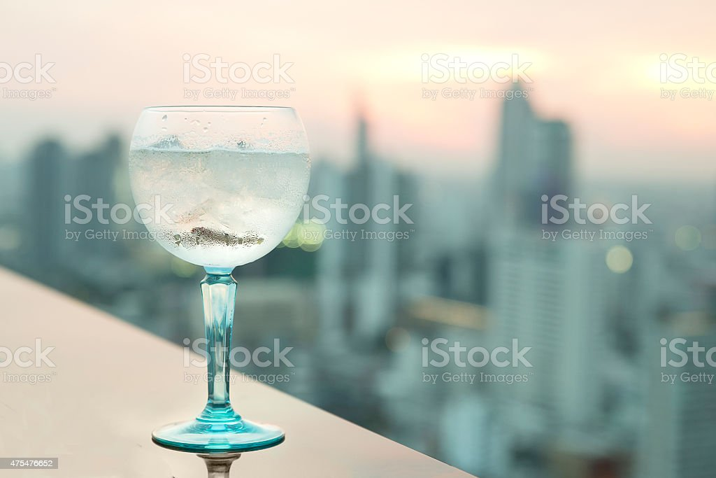 Gin tonic cocktail on table in rooftop bar stock photo