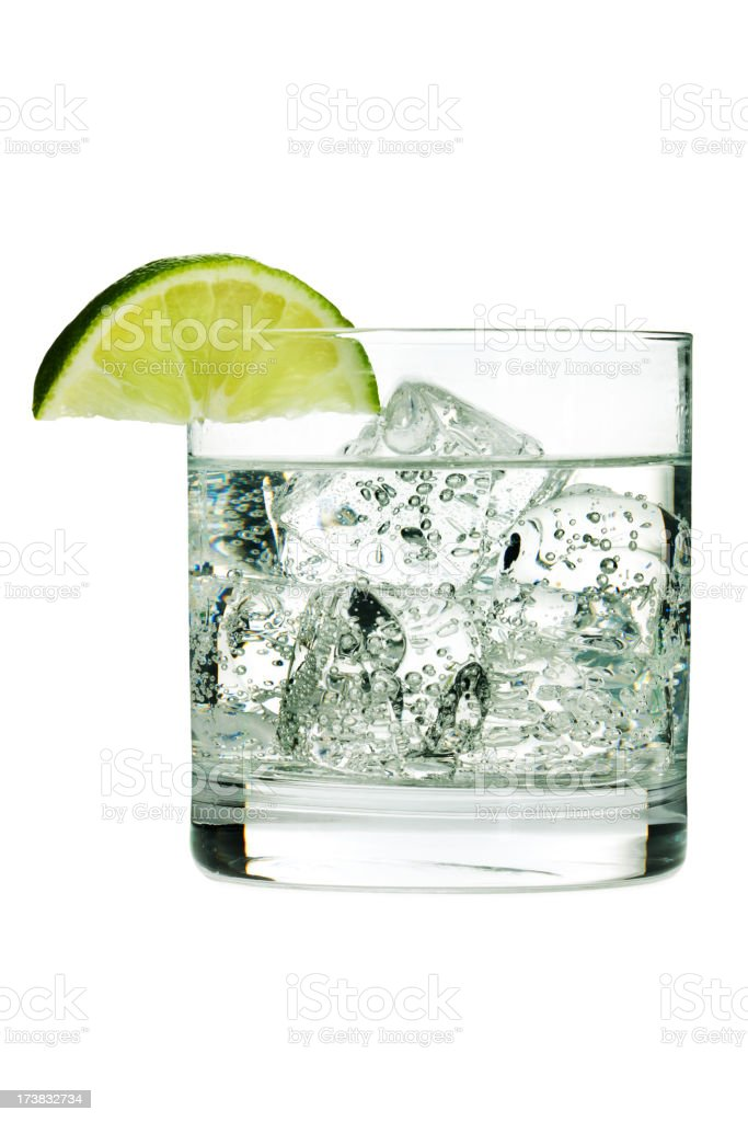 Gin Tonic Cocktail or Sparkling Water, in Glass with Lime stock photo