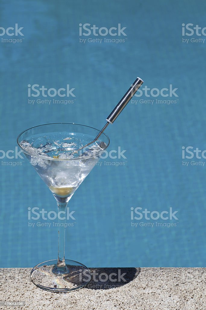 Gin tonic cocktail with swimming pool background royalty-free stock photo