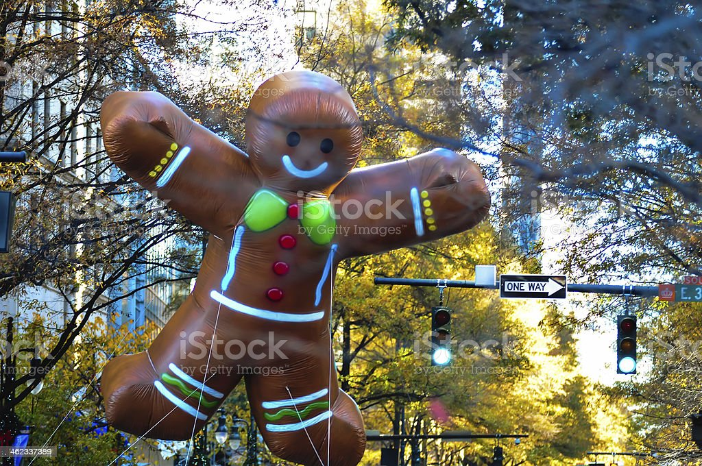 ginger bread cookie inflatable floating thru city streets stock photo