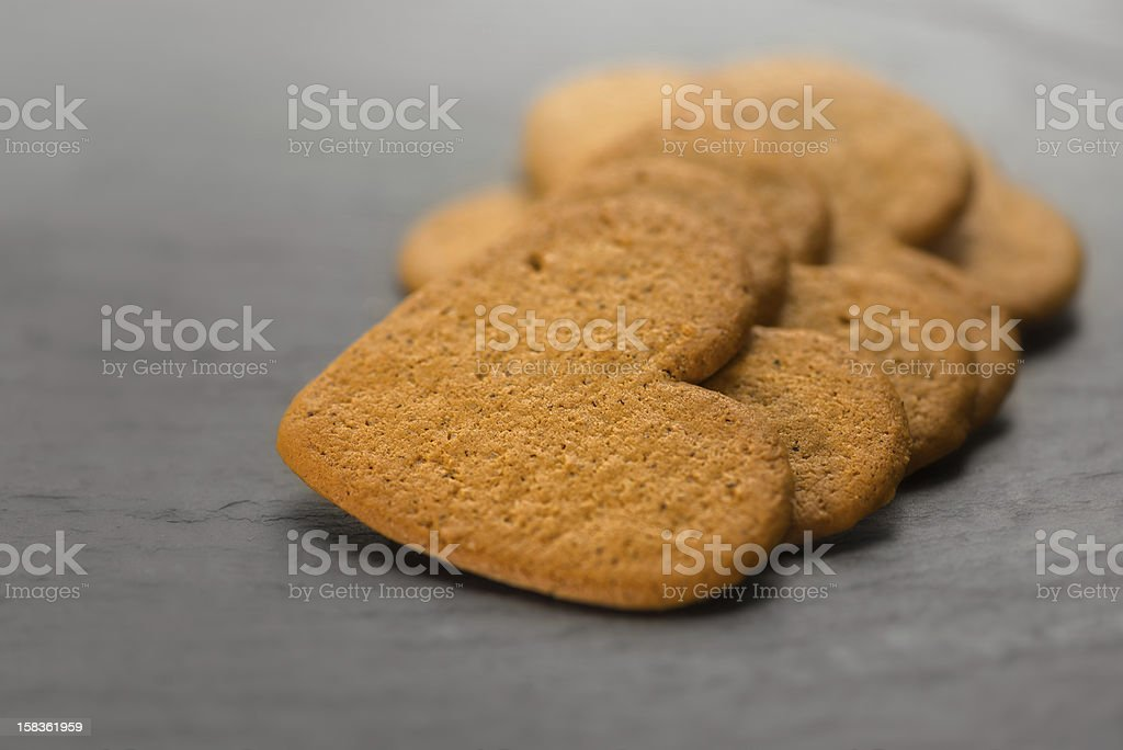 Ginger bread hearts on granite stone stock photo