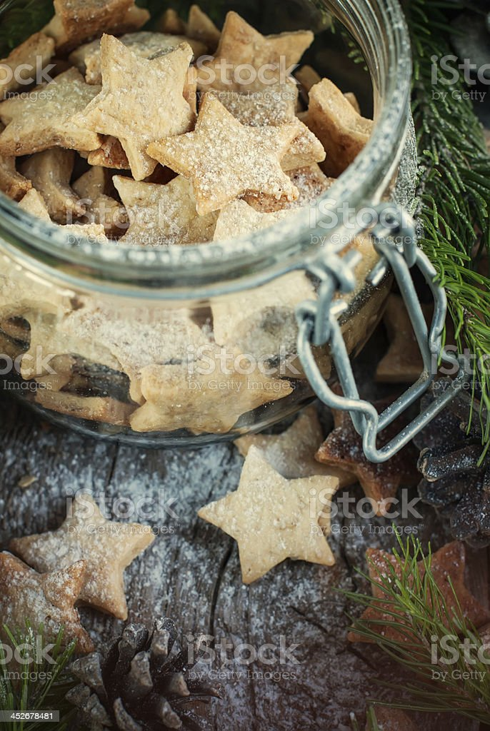 Ginger Christmas Cookies Stars in the jar stock photo