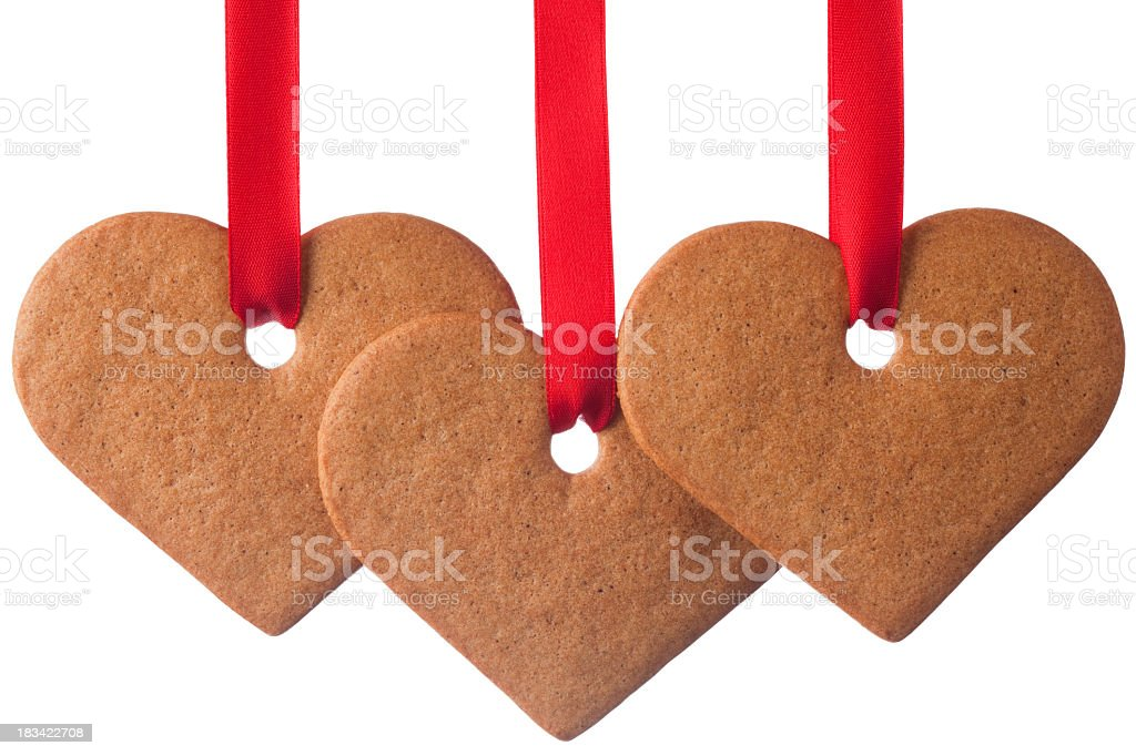 Ginger cookie heart ornaments on white background stock photo
