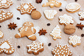 Ginger cookies, walnuts, coffee beans and anise on plywood background