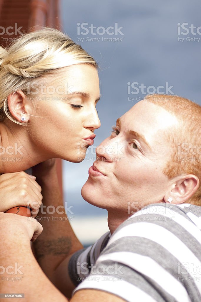 Ginger geting a kiss royalty-free stock photo