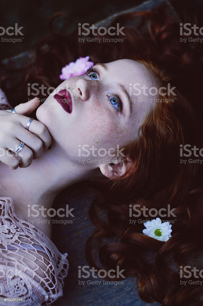 ginger girl laying down stock photo