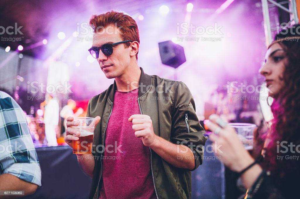 Ginger man enjoying in beer and music stock photo