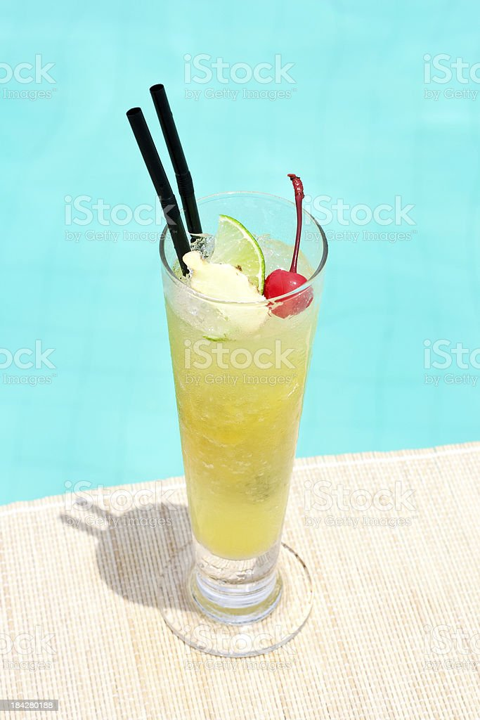Ginger Mango Punch cocktail near waterpool on the mat stock photo