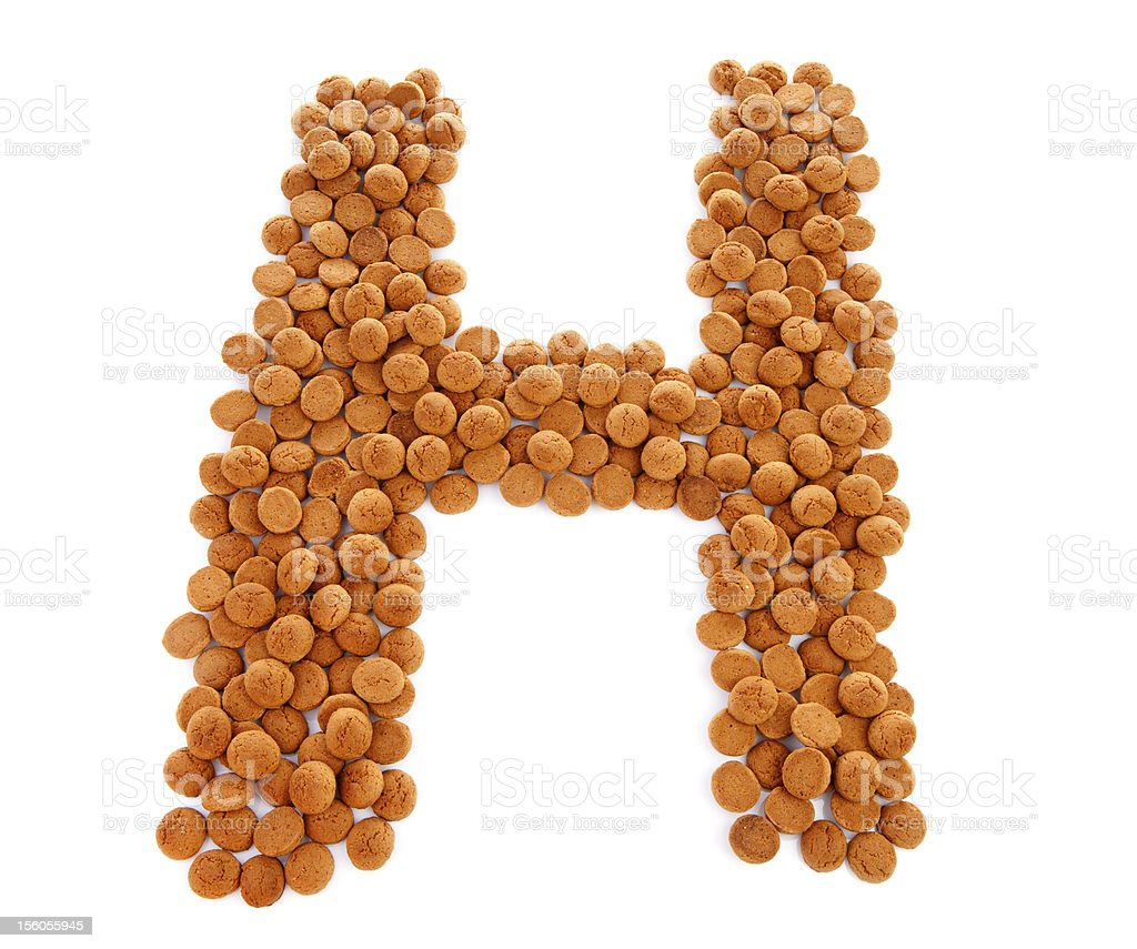Ginger nuts, pepernoten, in the shape of letter H royalty-free stock photo