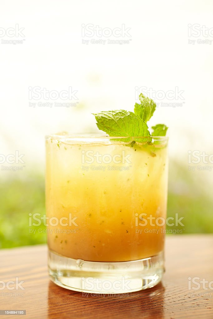 Ginger peach whiskey cocktail with mint royalty-free stock photo