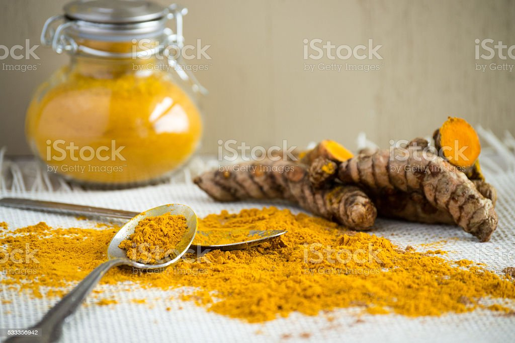 Ginger Root and ground ginger in classic jar stock photo