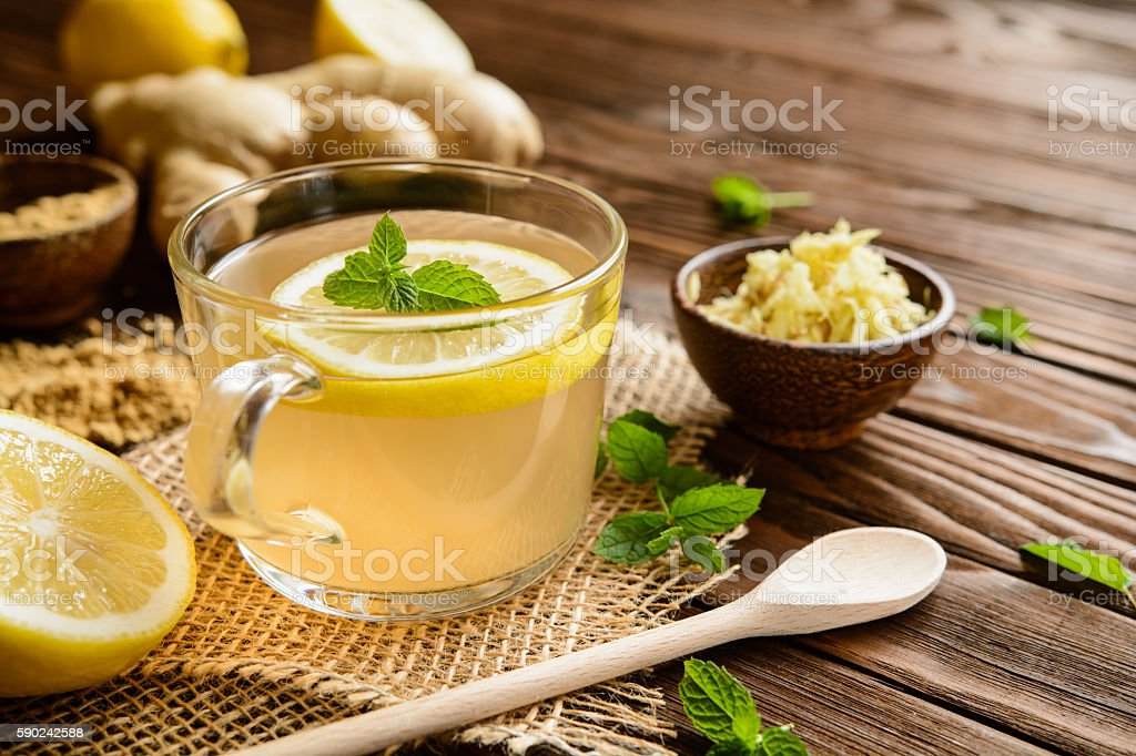 Ginger root tea with lemon, honey and mint stock photo