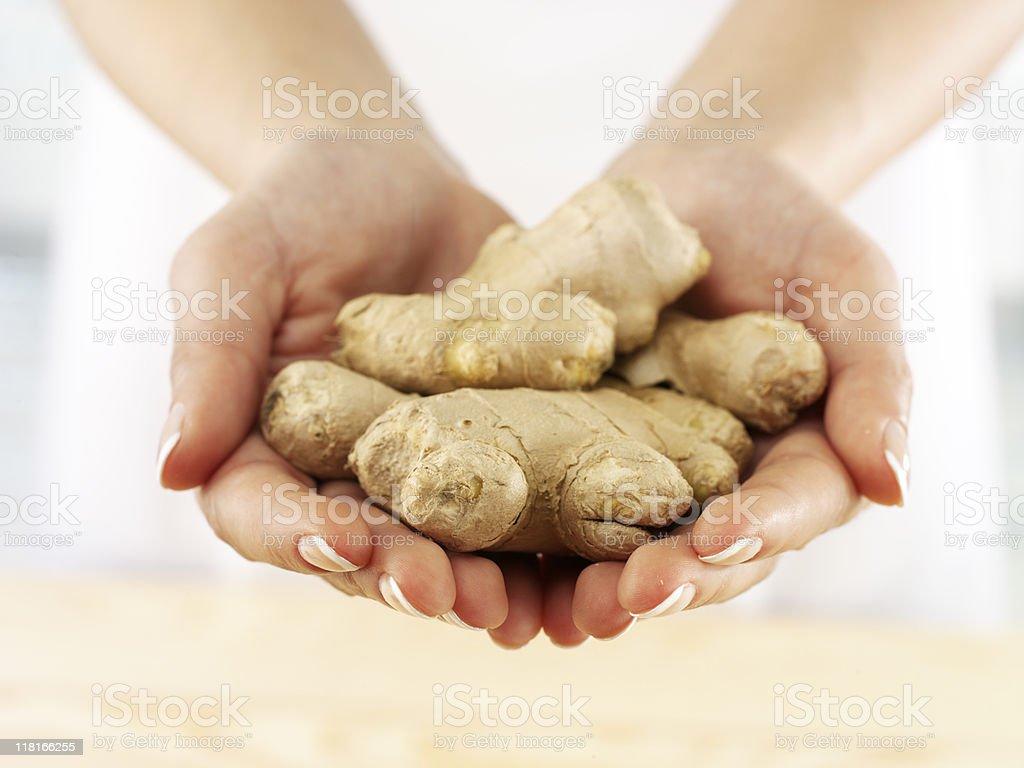 woman holding fresh ginger