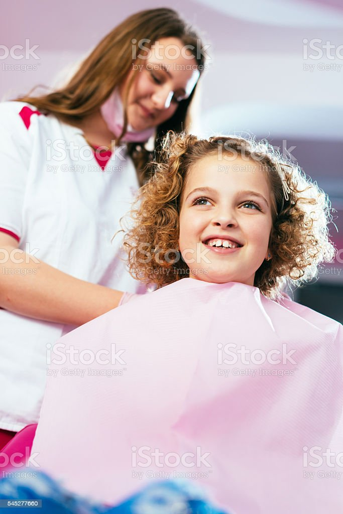 Ginger school girl at dentist stock photo