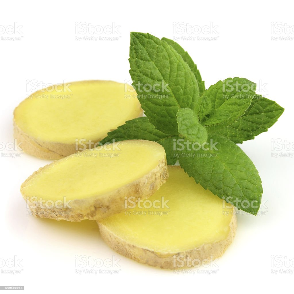 Ginger slice with mint royalty-free stock photo