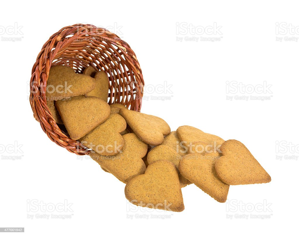 Ginger snap cookies spilling from basket stock photo