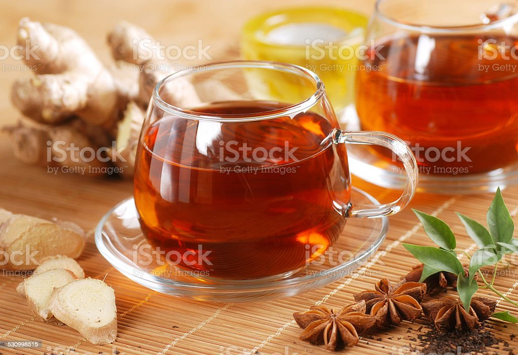 ginger tea in glass cup stock photo
