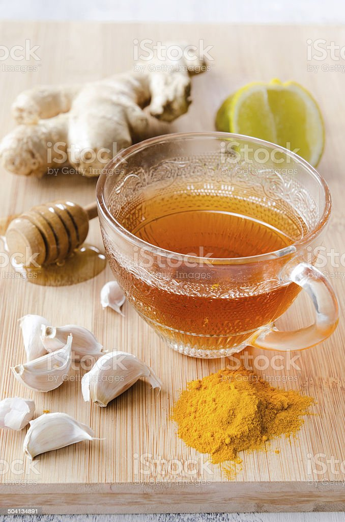 Ginger tea with lemon. honey and tumeric for detox stock photo