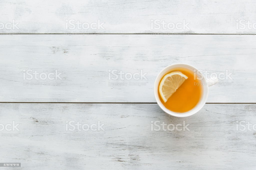 Ginger tea with lemon on the wooden background stock photo