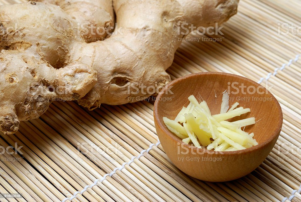 Ginger whole and chopped closeup royalty-free stock photo