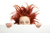 Ginger woman having bad hair day holding a blank board