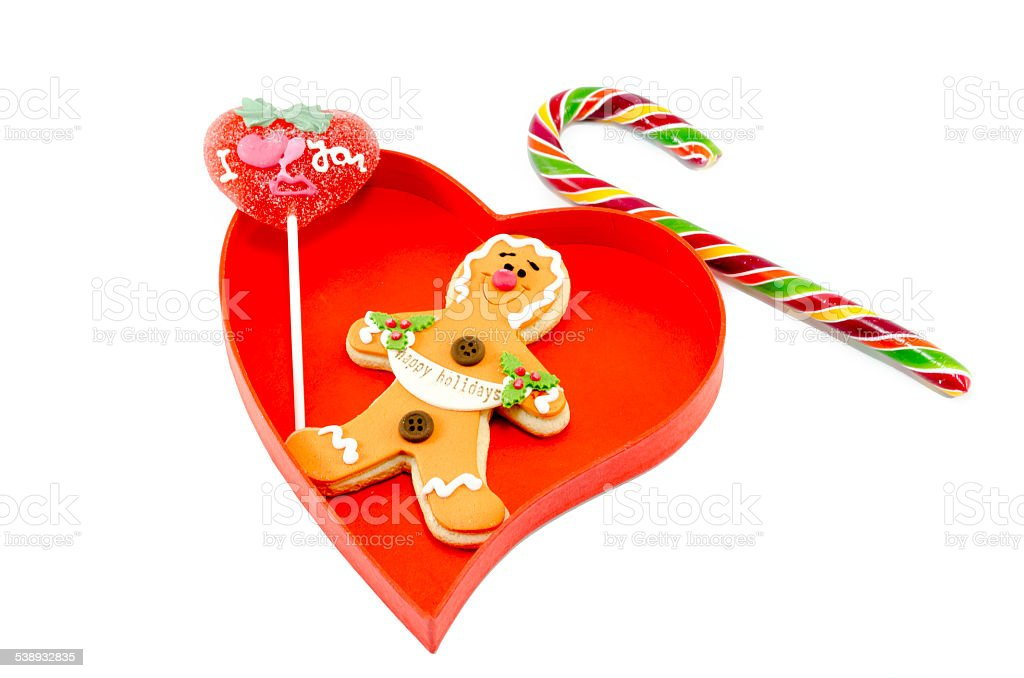 Gingerbread a candy cane and a lollipop in box royalty-free stock photo