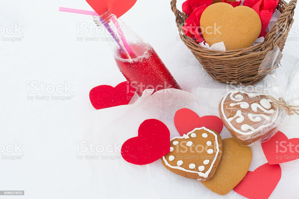 Gingerbread and lemonade with paper hearts on the snow stock photo