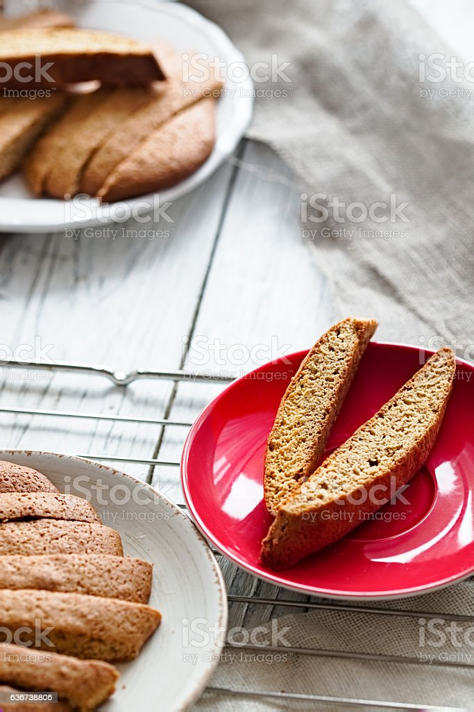 Gingerbread biscotti on a white plate stock photo