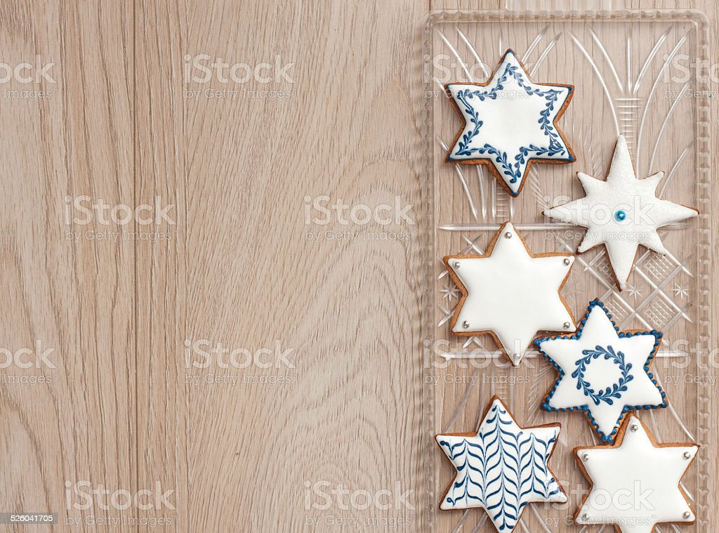 Gingerbread biscuits decorated with royal icing in white and blue. stock photo
