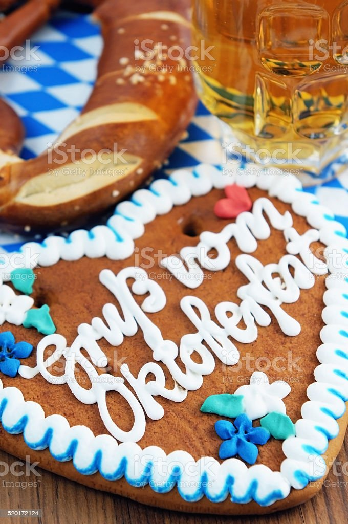 gingerbread cake with Oktoberfest message and beer in background stock photo