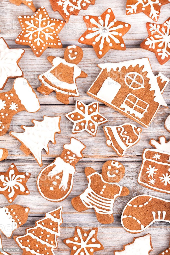 Gingerbread Christmas cookies full frame on wooden table. stock photo