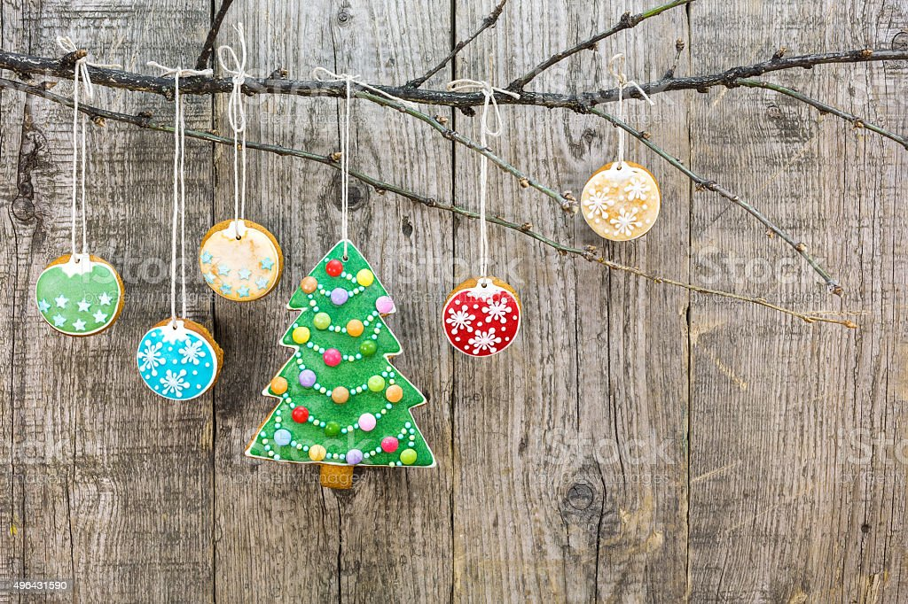 gingerbread christmas tree with hanging cookies stock photo