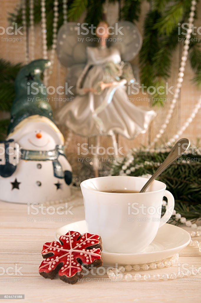 Gingerbread cookie and cup of tea. Christmas New Year holiday stock photo
