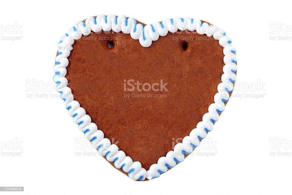 A gingerbread cookie in the shape of a heart royalty-free stock photo